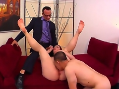 Cuckold redhead Melody Jordan with juicy zeppelins and gigantic round ass receives licked and fucked hard on couch in wild and spontaneous threesome with Kurt Lockwood and Erick Jover.