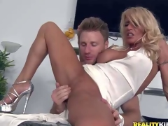 Shes a super sexy milf with blond hair and flawless long slim legs. This babe removes her white panties and gets her tight totally shaved snatch finger fucked and fisted by MILF Hunter. He love sher tight hole