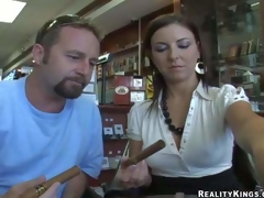 Busty and handsome milf in white shirt and black skirt receives enticed by a hunky charming dude in a cigarette shop and receives caught on camera with him