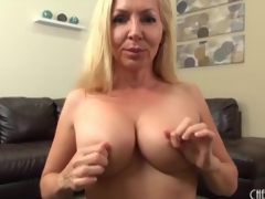 Milf caresses her fake tits in close up