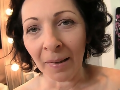 The horny mature works her lovely lips up and down that big cock